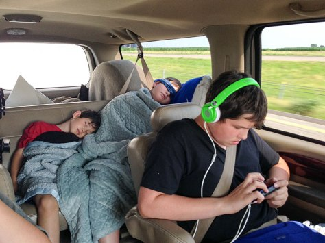 Kids sleeping and watching a movie on iPhone